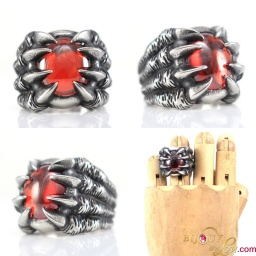 steel_oval_red_gem_claws_ring